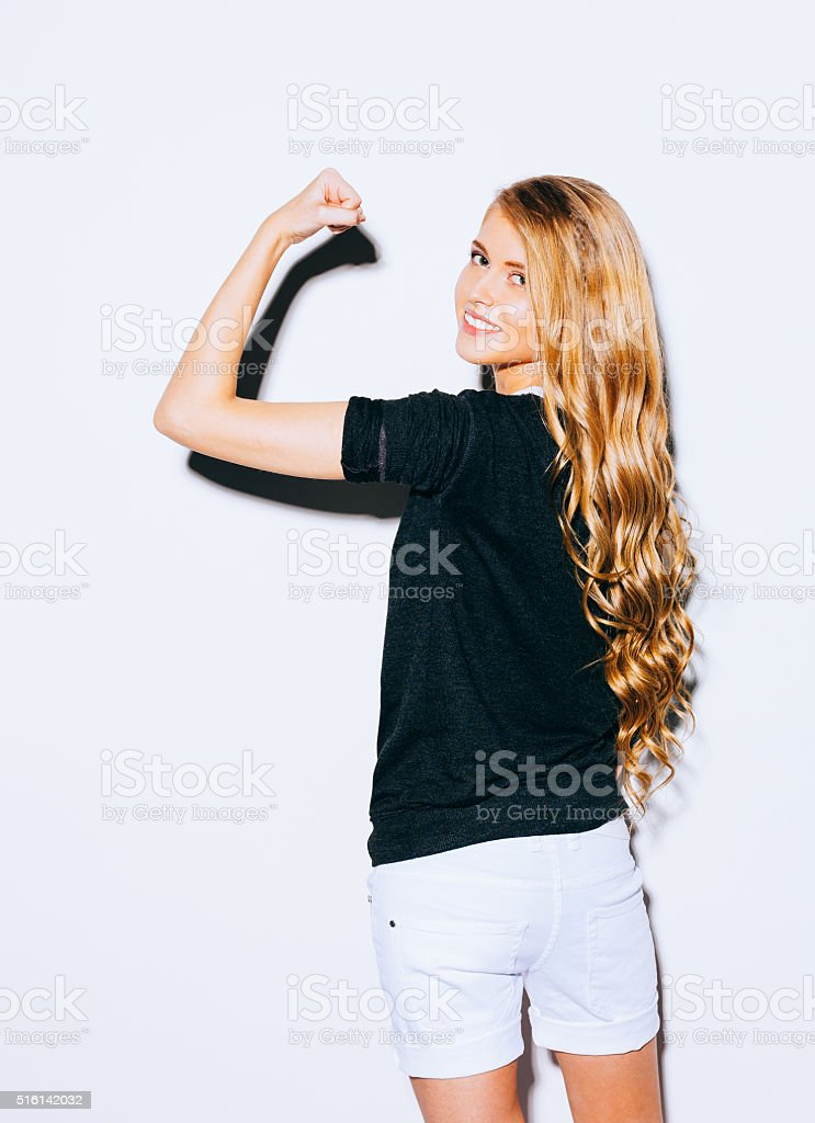 Young beauty fitness sexy blonde woman showing her muscles stock photo