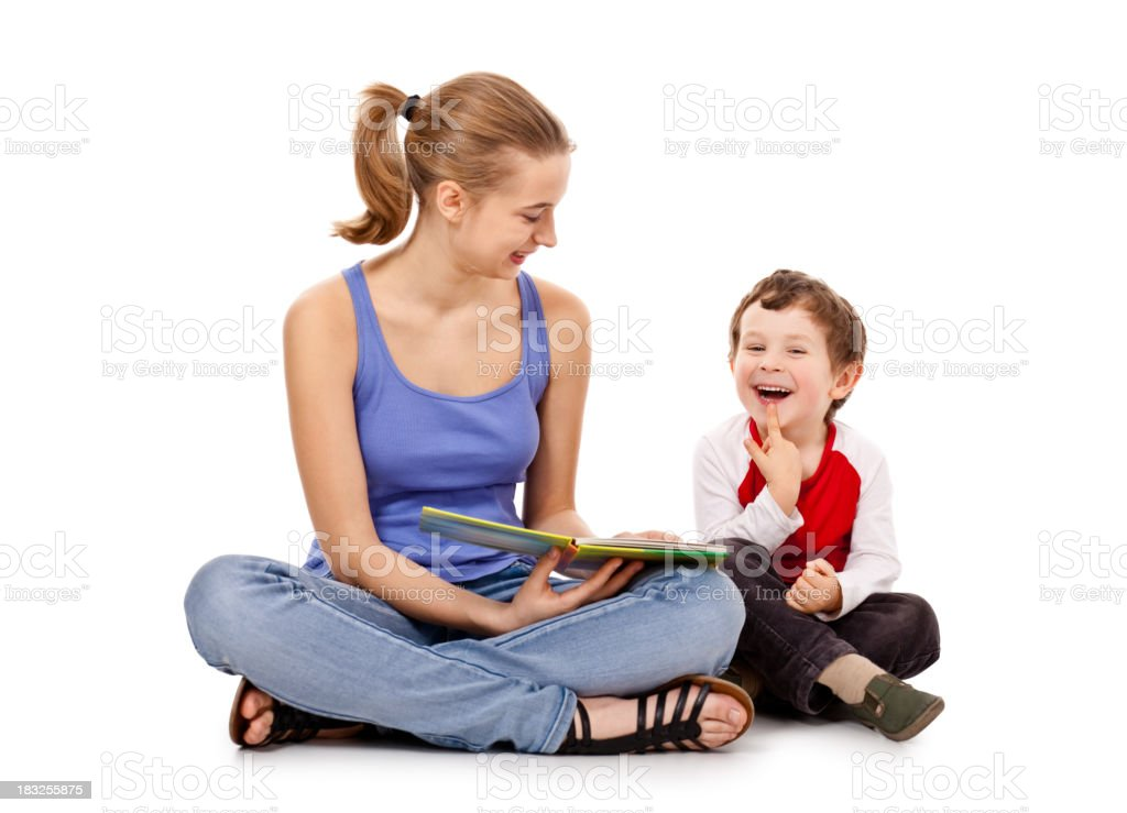 young beauty girl reading book  with small boy royalty-free stock photo