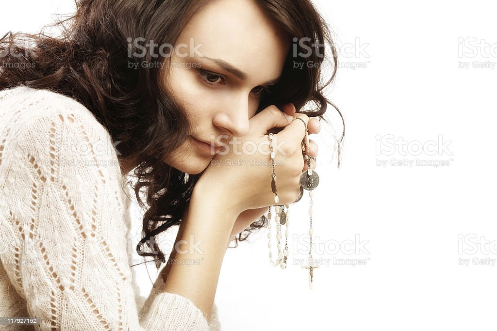 young beauty is praying in white royalty-free stock photo