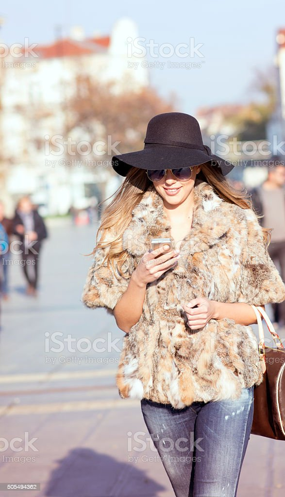 Young beauty on the urban street stock photo