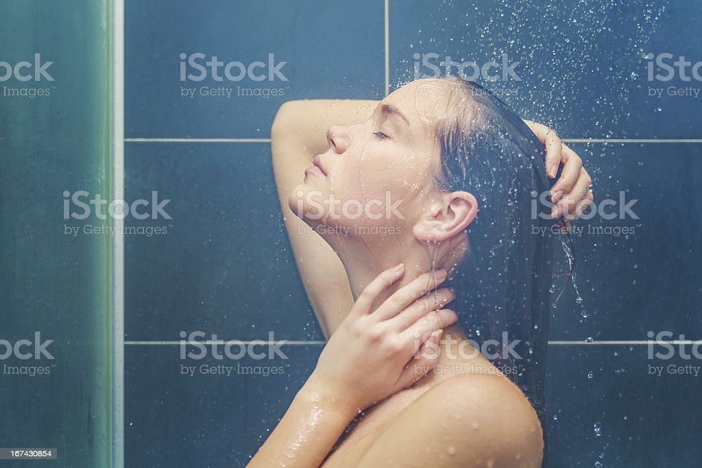 Young beauty under shower royalty-free stock photo