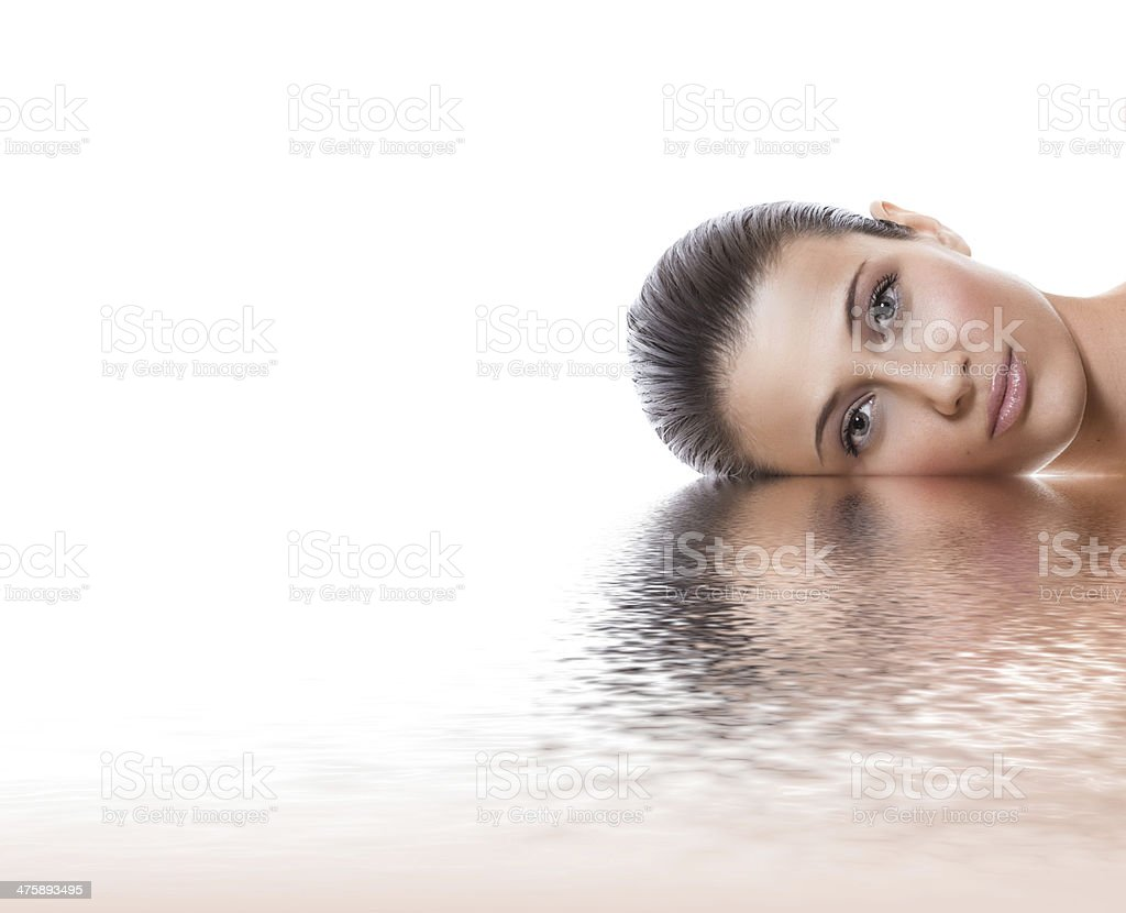 Young beauty woman lying down, isolated on white background stock photo