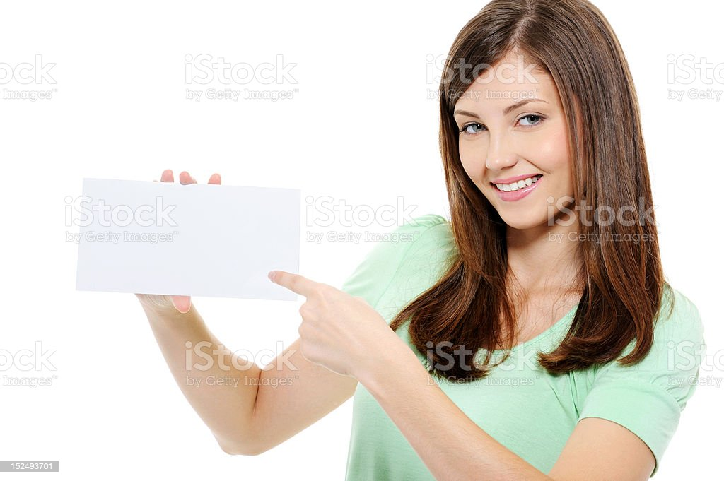 Young beauty woman pointing on the blank card royalty-free stock photo