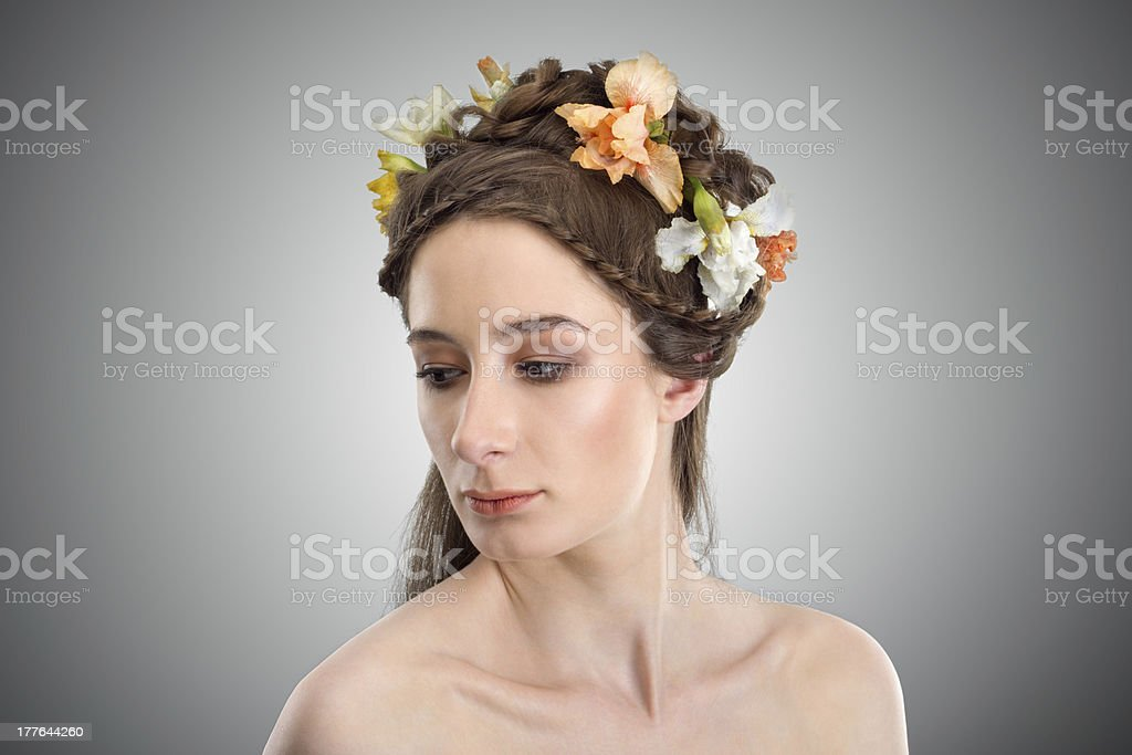 Young beautyfull woman with flowers in her hair royalty-free stock photo
