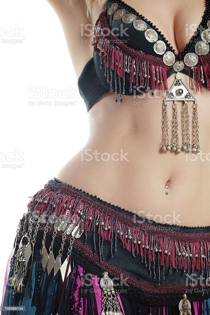 A young belly dancers midsection stock photo