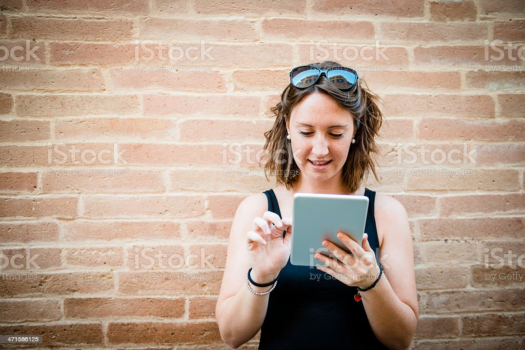 Young bewildered woman with digital tablet royalty-free stock photo