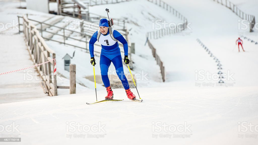 Young biathlon competitor in a gentle slope stock photo