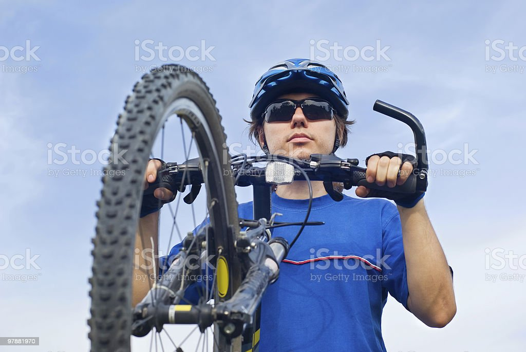 young bicyclist in helmet royalty-free stock photo