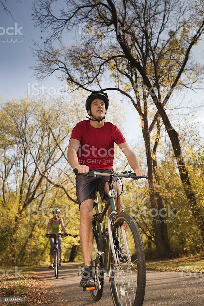 Young Bicyclists Exercising in Autumn for Healthy Lifestyle stock photo