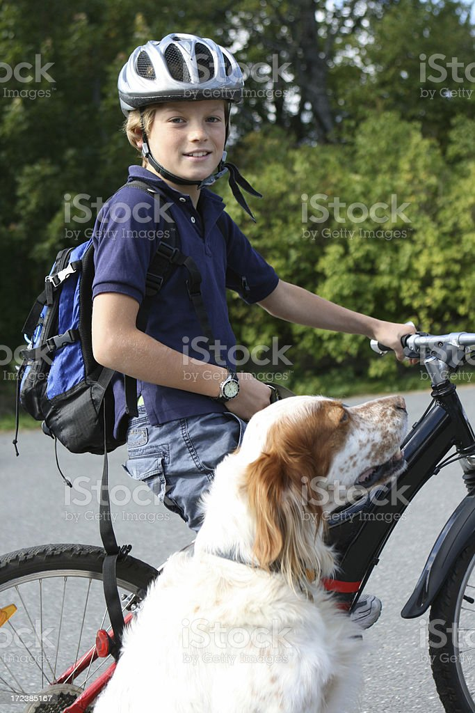 Young biker and his dog., Norway stock photo