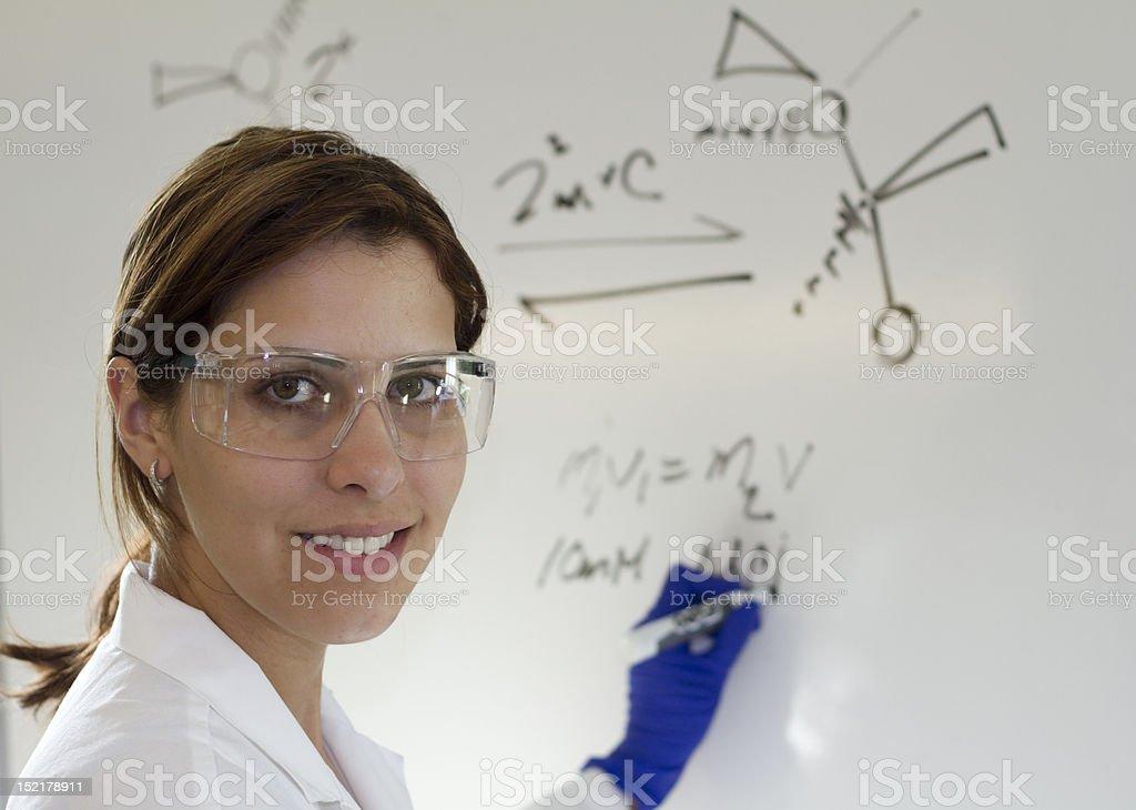 young biologist chemist writing formula royalty-free stock photo