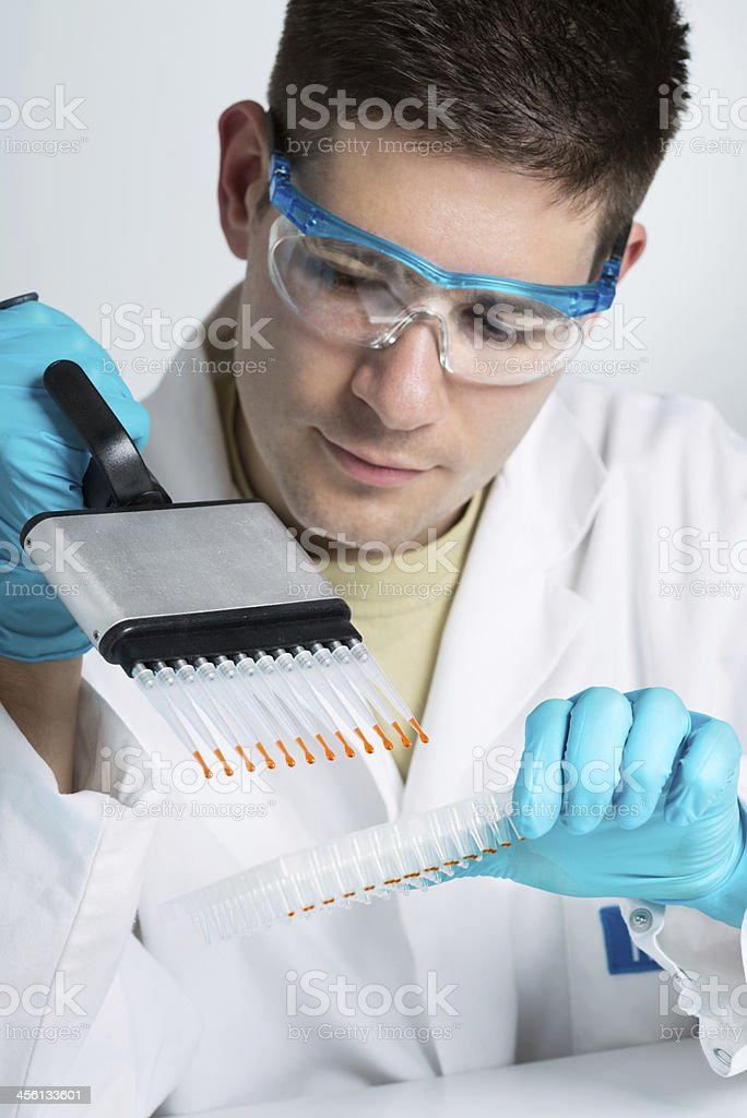 Young biologist with multichannel pipette stock photo