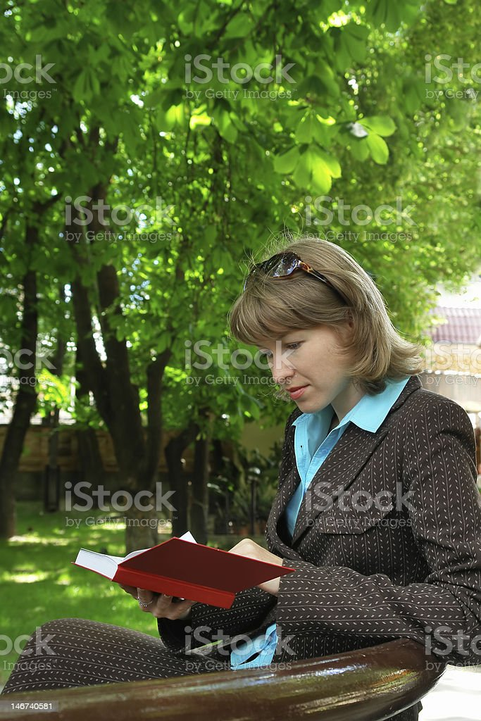 young bisness-woman read book in park stock photo