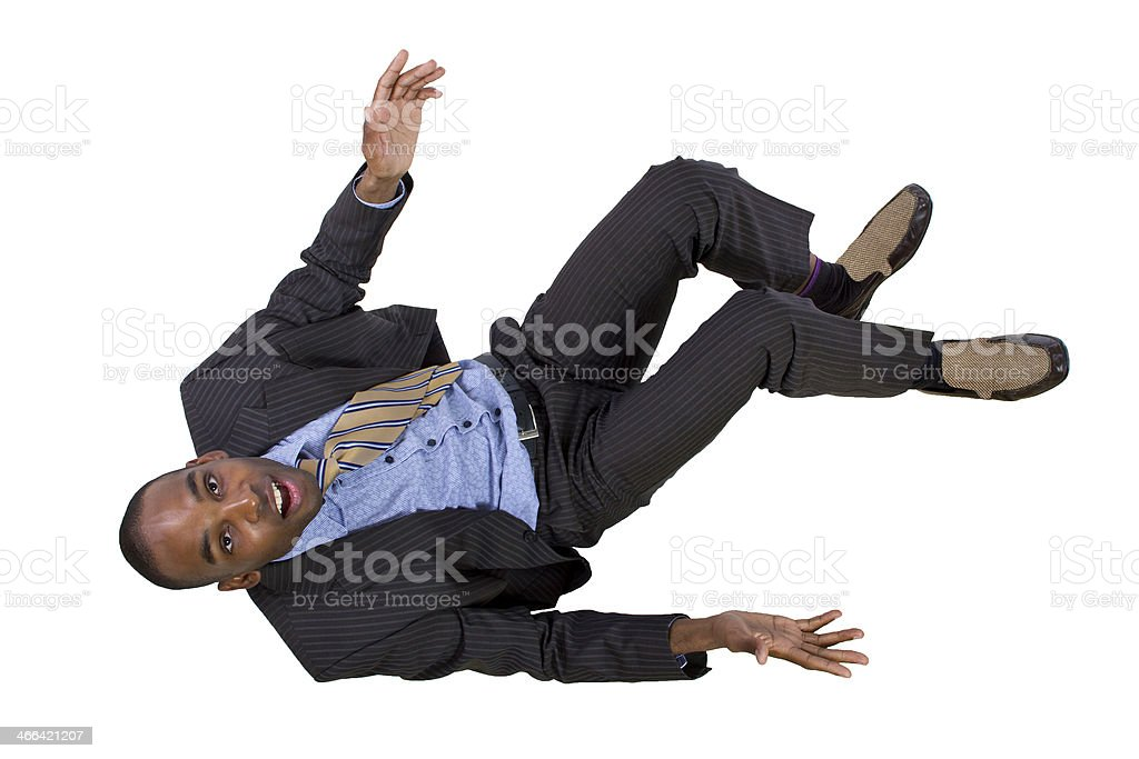 Young Black Businessman Falling Backwards stock photo