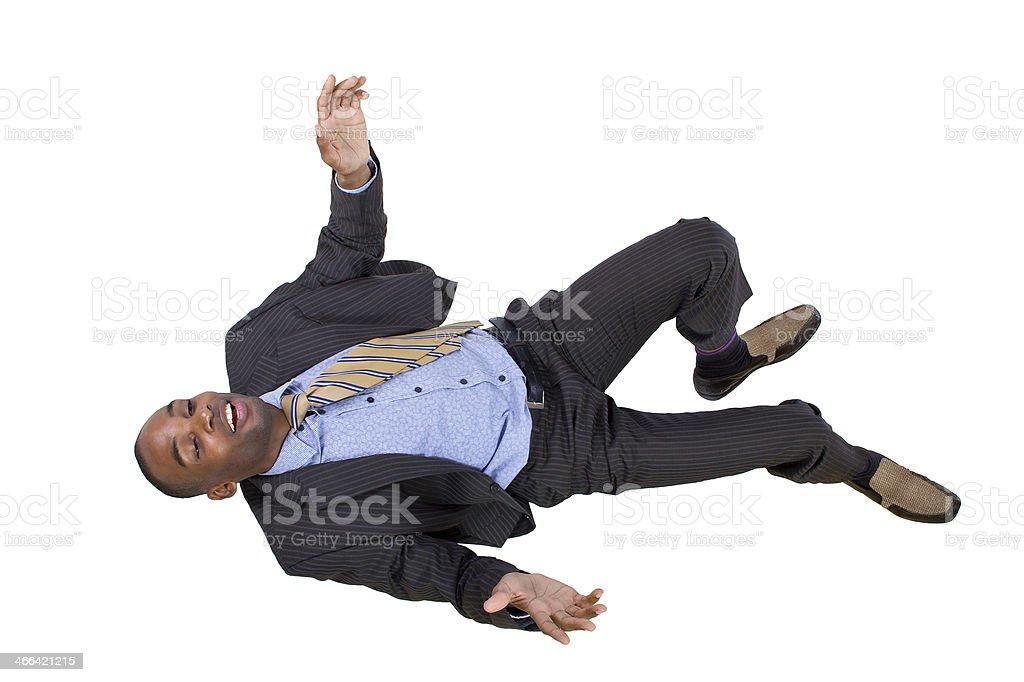 Young Black Businessman Falling Backwards stock photo