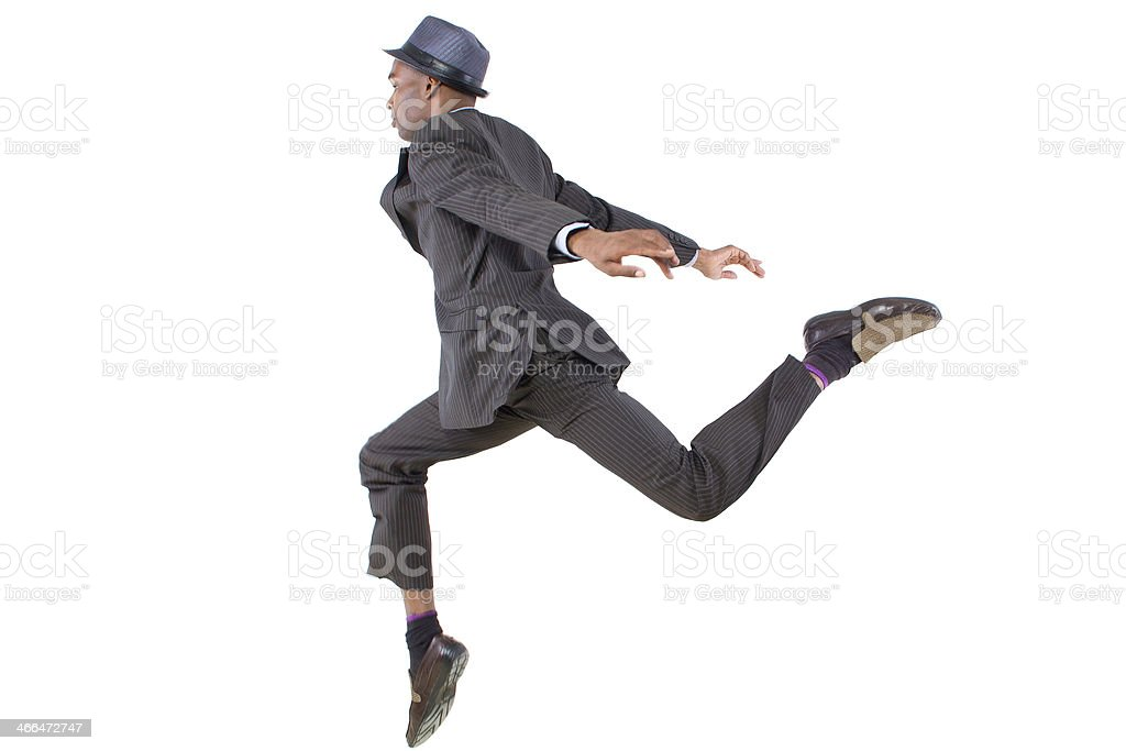 Young Black Businessman Jumping the Leap of Faith stock photo