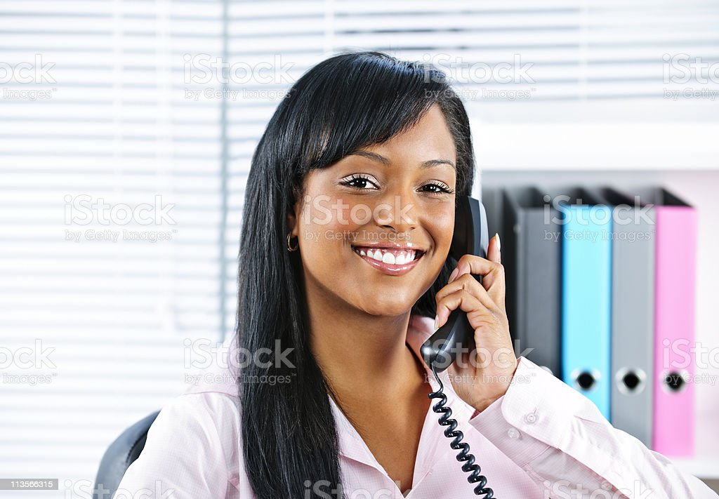 Young black businesswoman talking on phone stock photo