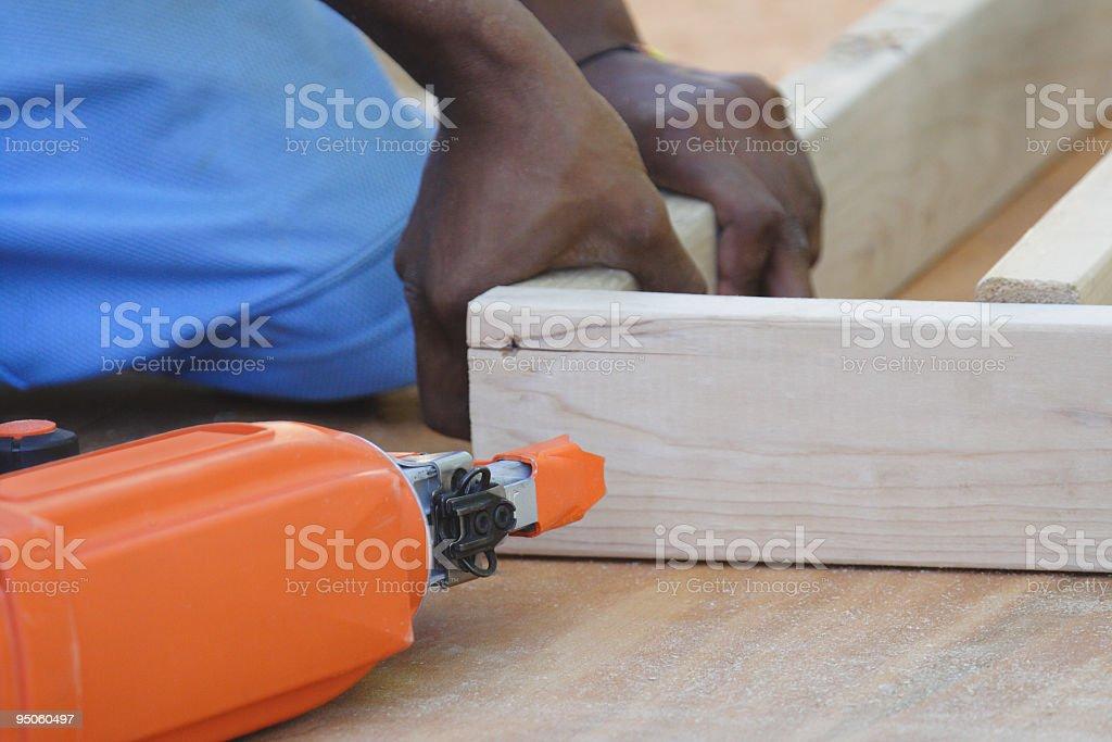 Young Black Carpenter With Nail Gun stock photo