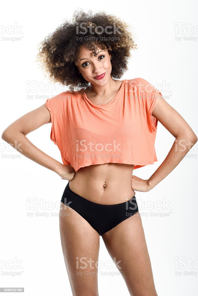 Young black girl with afro hairstyle smiling on white background stock photo