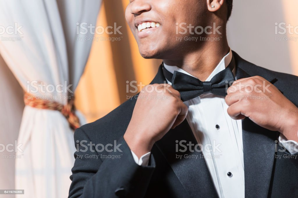 Young black Hispanic man wearing tuxedo stock photo