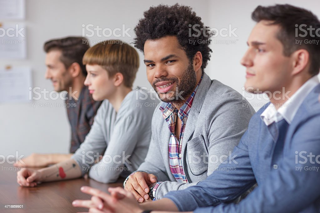Young black male entrepreneur in business meeting royalty-free stock photo