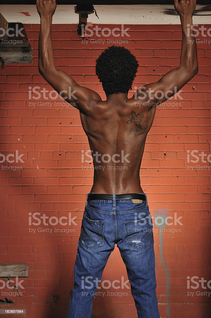 Young black man from the back royalty-free stock photo