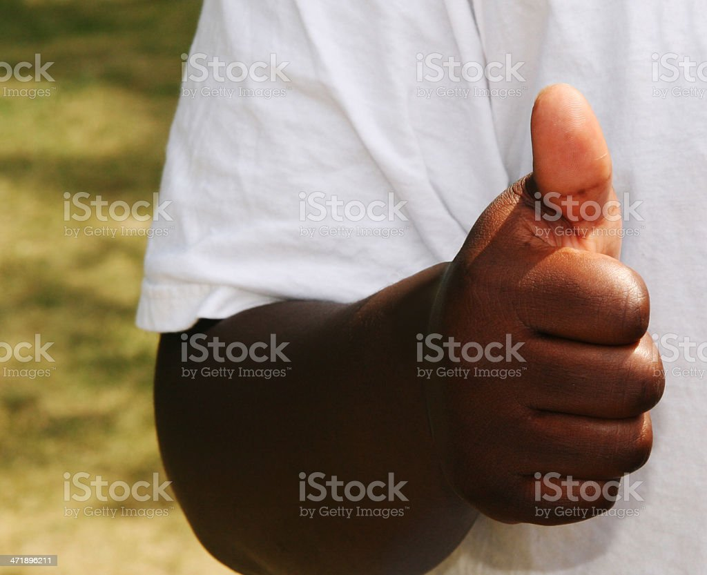 Young black man giving thumbs up sign. royalty-free stock photo