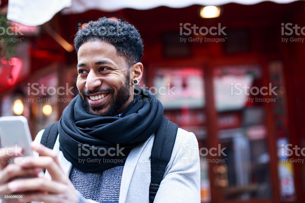 Young black man having fun in Latin Quarter stock photo