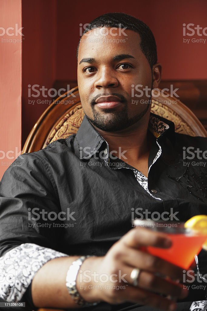 Young Black Man With Cocktail In Old Bar Saloon stock photo