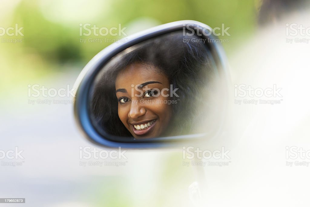 Young black teenage driver seated in her new convertible car royalty-free stock photo