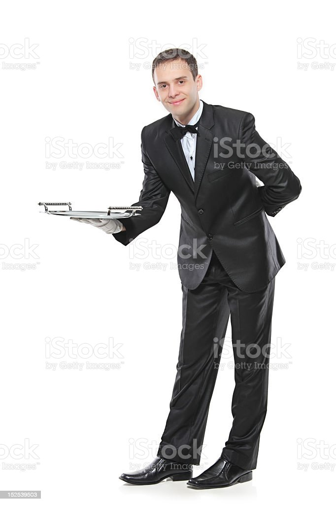 Young black tie waiter holding silver tray stock photo