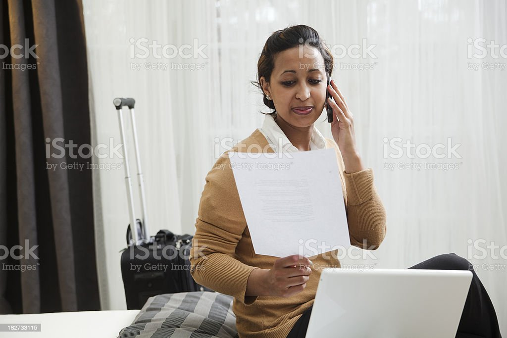Young Black Woman Business Traveler Working in Hotel Room Hz royalty-free stock photo
