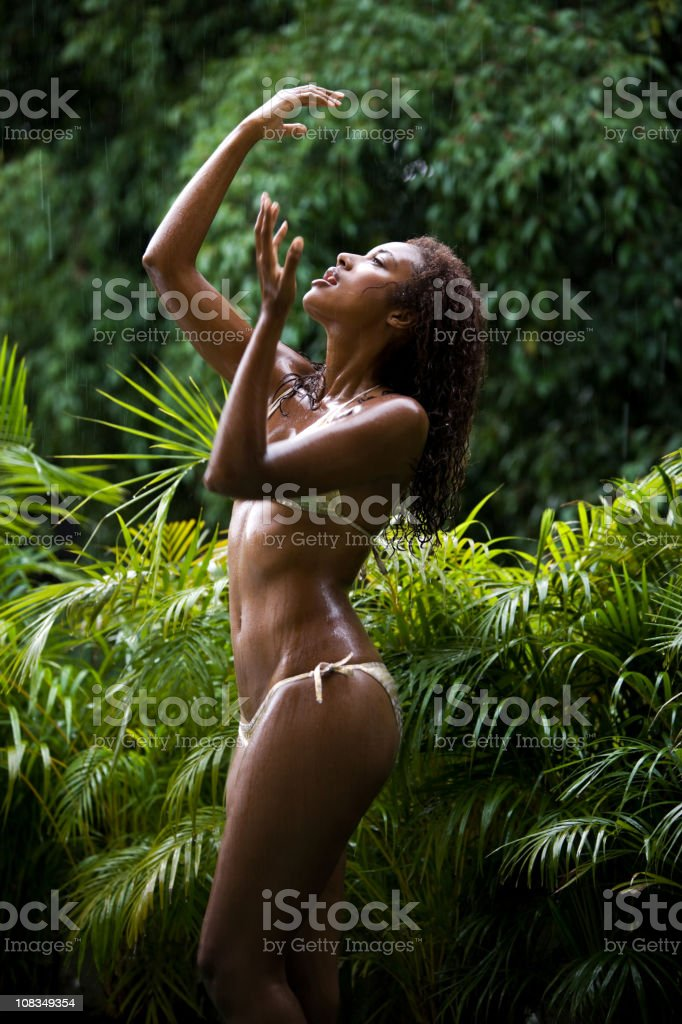 Young black woman dancing in the rain royalty-free stock photo
