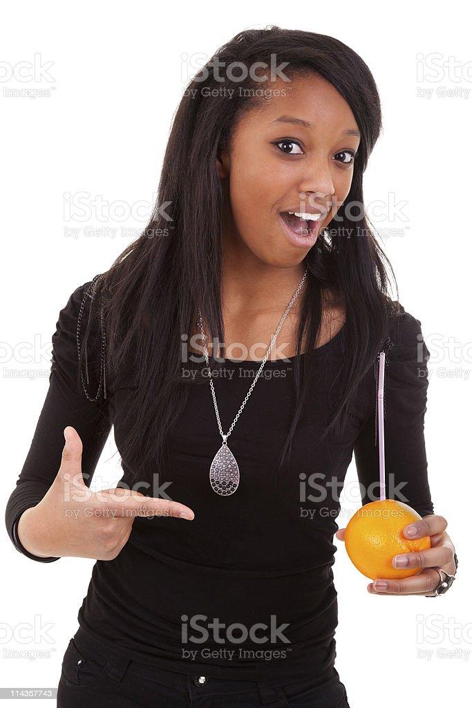 young black woman drinking orange juice royalty-free stock photo