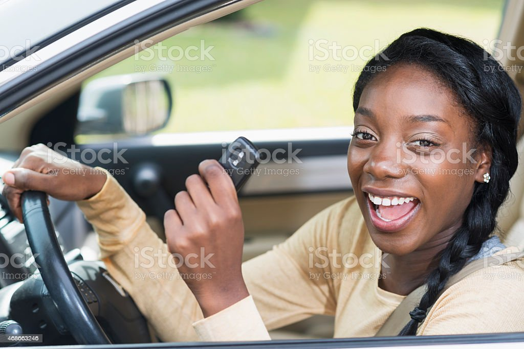 Young black woman driving car stock photo