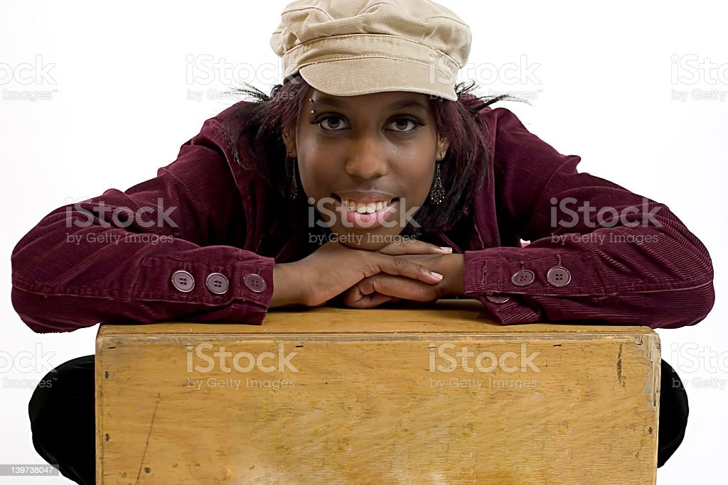 Young black woman leaning on a box with room for copy space stock photo