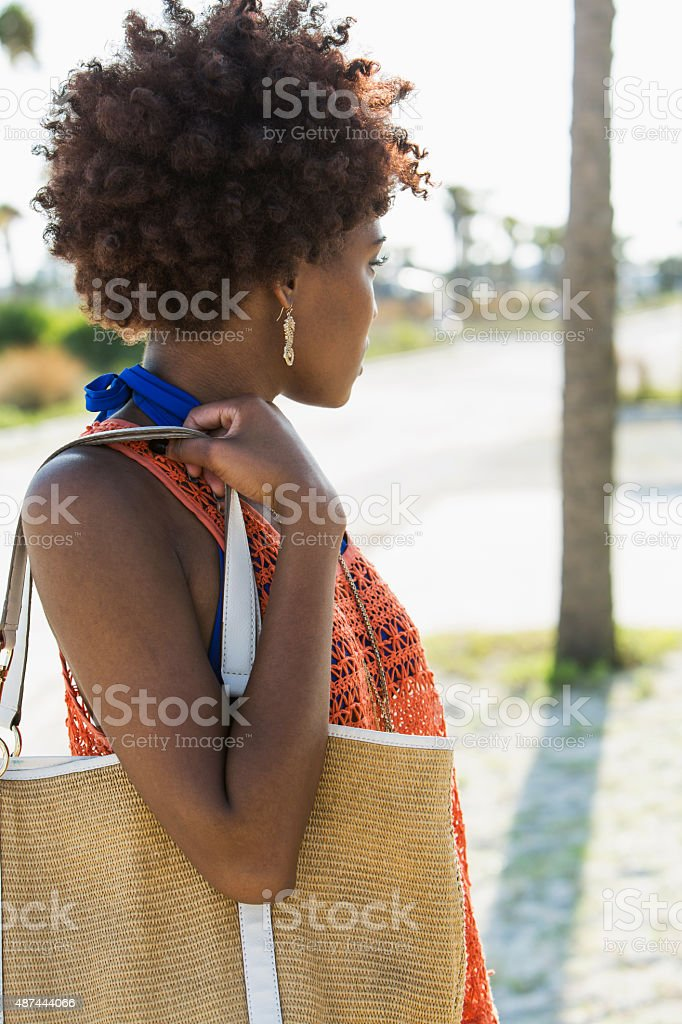 Young black woman on sunny summer day stock photo