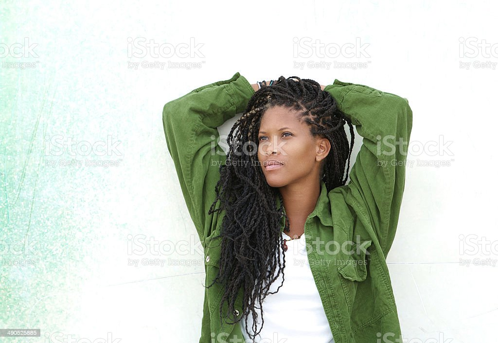 Young black woman relaxing outdoors stock photo
