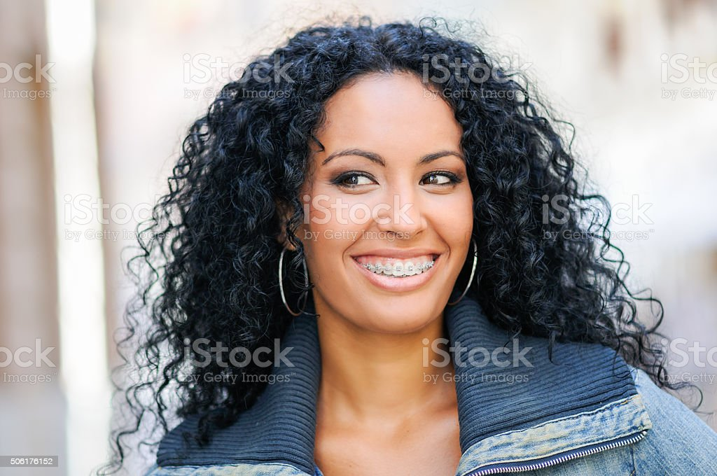 Young black woman smiling with braces stock photo