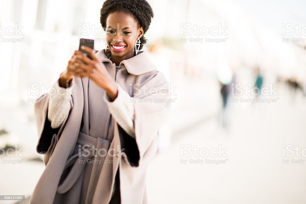 Young black woman taking selfie outdoor stock photo