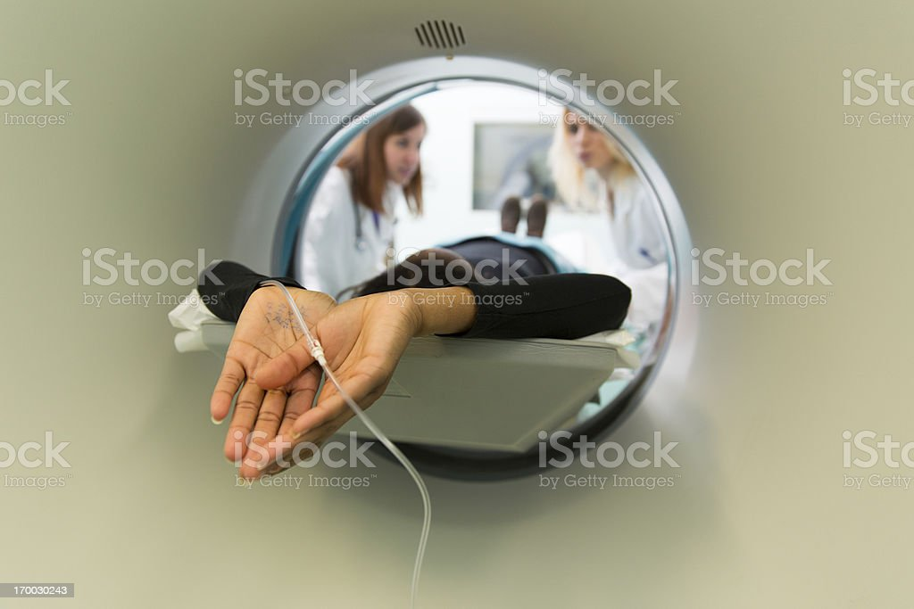 Young black woman waiting for CAT scan with contrast royalty-free stock photo