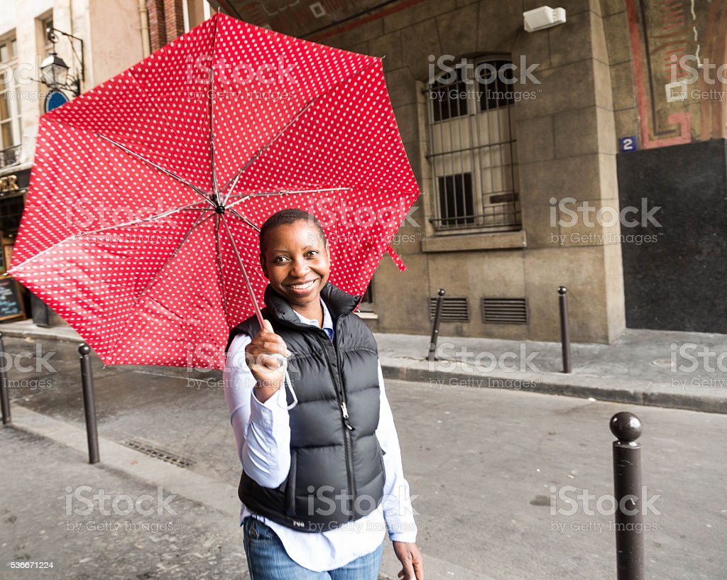 young black woman with red umbrella stock photo