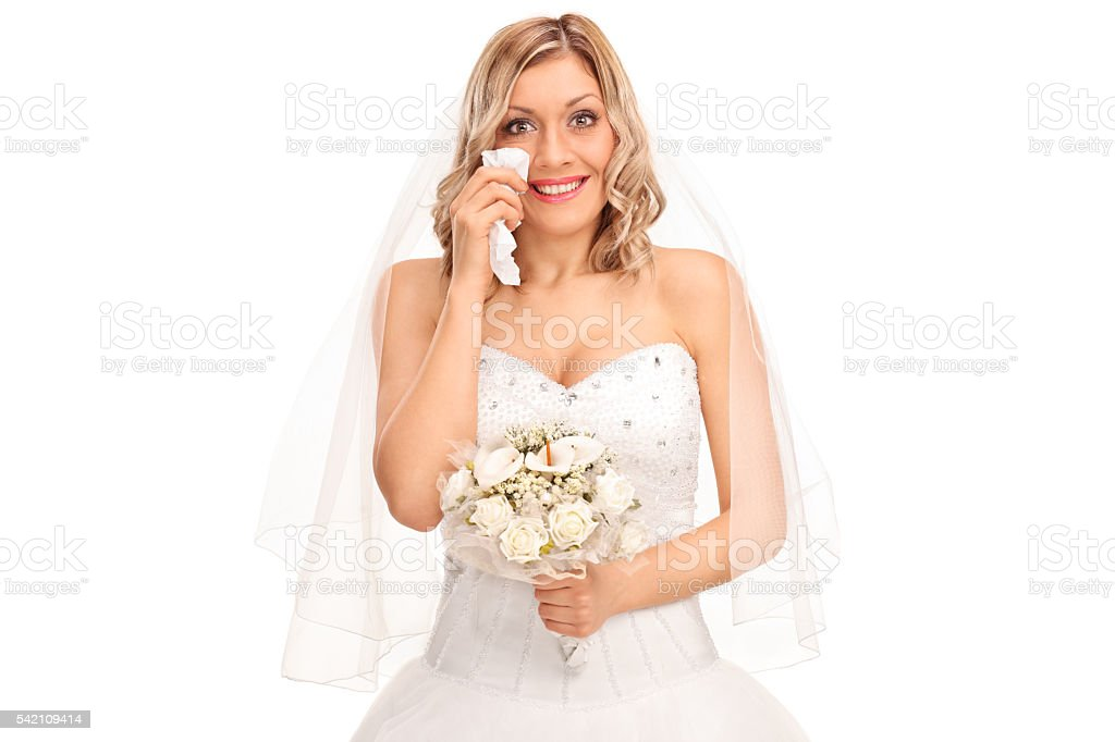Young blond bride crying out of joy stock photo