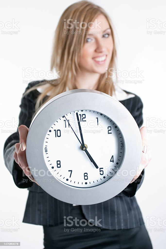 Young blond business woman with clock in hands royalty-free stock photo