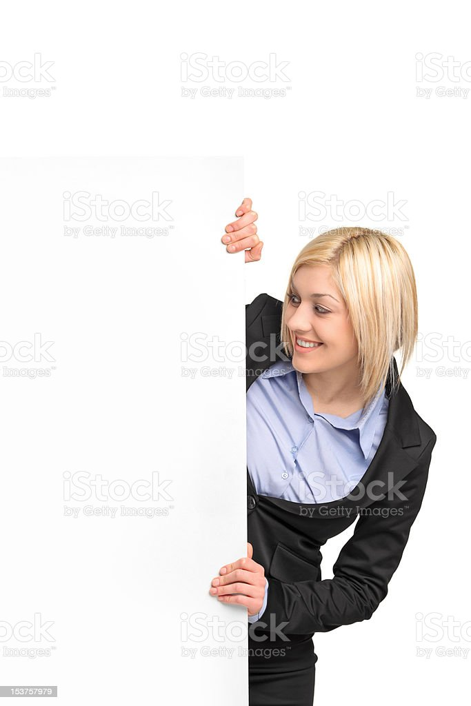 Young blond businesswoman looking at banner royalty-free stock photo