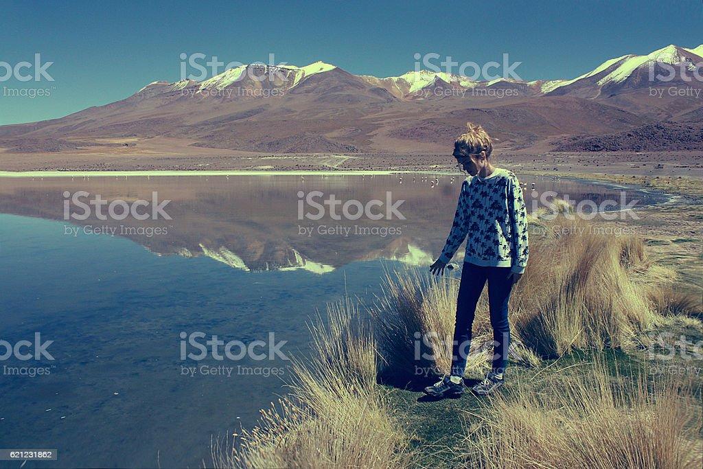 young blond caucasian woman at Laguna Colorada, Bolivia stock photo