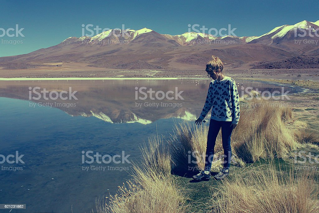 young blond caucasian woman at Laguna Colorada, Bolivia stock photo