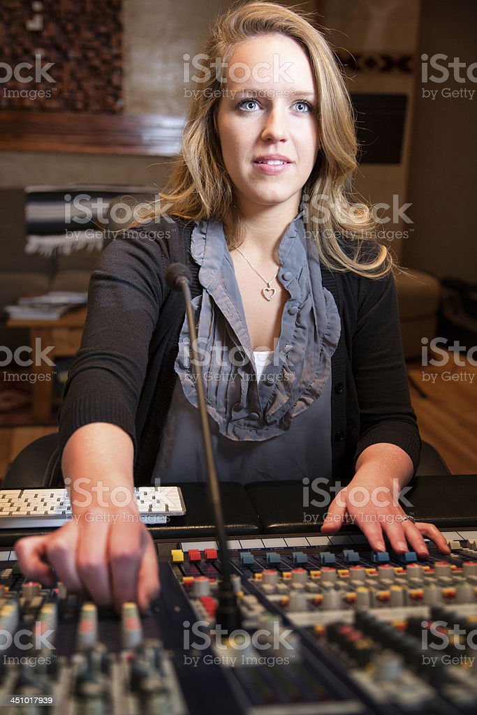 Young Blond Caucasian Woman in her 20s  Recording Console royalty-free stock photo