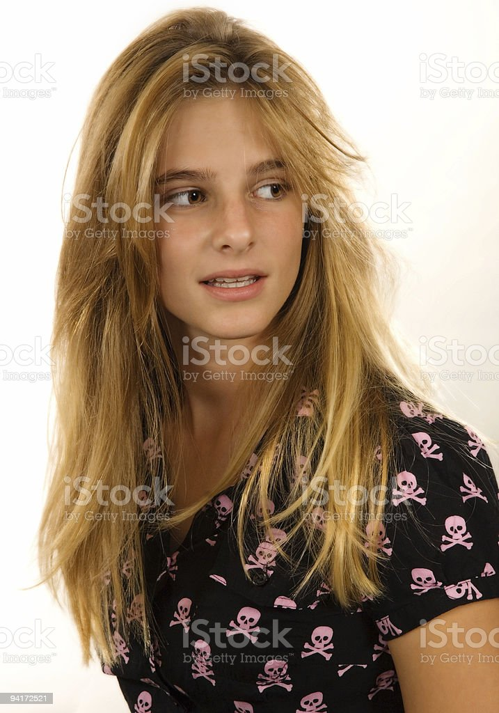 young blond girl smiling whilst looking away royalty-free stock photo
