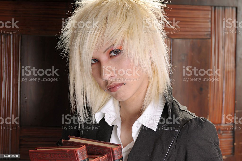 Young blond man with books stock photo